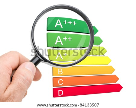 Hand with magnifying glass looking at the new A+, A++ and A+++ classes of the european energy efficiency classification