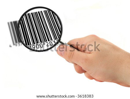 hand with magnifying glass scanning bar code (bar code is FAKE, no copyright infringement)