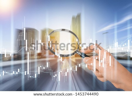 Hand with magnifying glass with infographics on the road background #1453744490