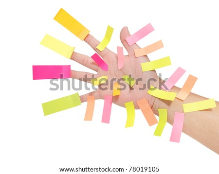 Hand with many blank sticky notes