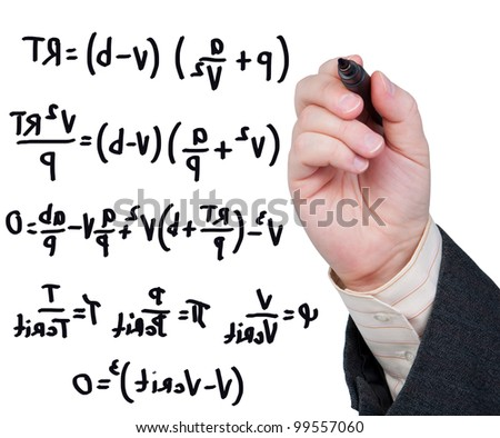 Hand with marker writing formulas and equations.