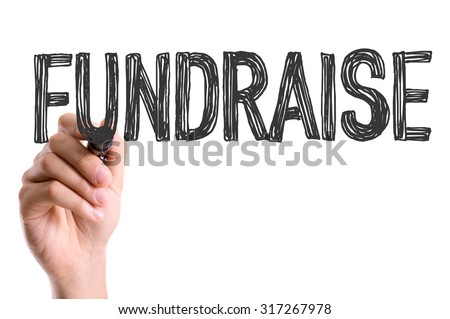 Hand with marker writing: Fundraise #317267978