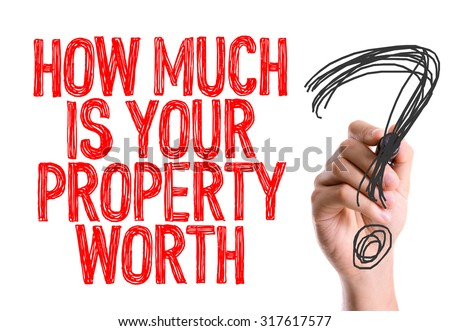 Hand with marker writing: How Much Is Your Property Worth?