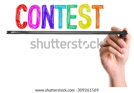 Hand with marker writing the word Contest #309261569