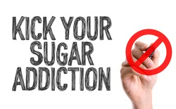 Hand with marker writing the word Kick Your Sugar Addiction
