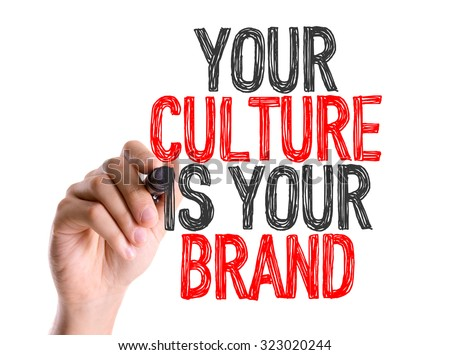 Hand with marker writing: Your Culture Is Your Brand #323020244
