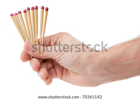 Hand with matches on a white background