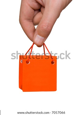 Hand with mini bag isolated on white background