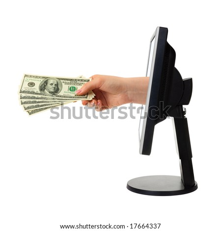 Hand with money and computer monitor isolated on white background
