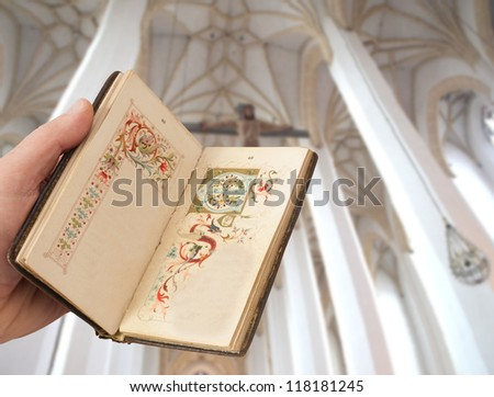 hand with old book of prayers