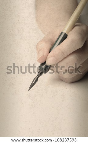 hand with old style pen