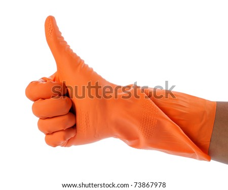 hand with orange cleaning product glove showing thumb up