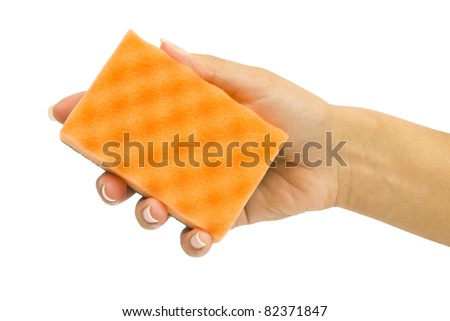 Hand with orange sponge on white background