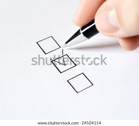 Hand with pen and check box, isolated on white background