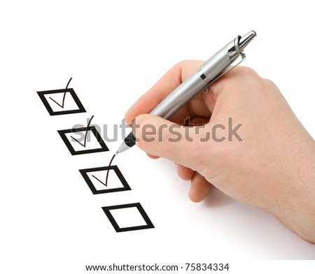 Hand with pen and check boxes isolated on white background - stock photo
