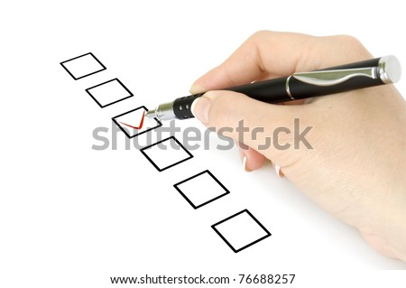 Hand with pen choosing one of three options