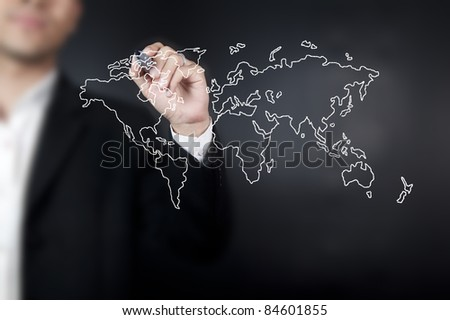 Hand with pen drawing a world map in whiteboard
