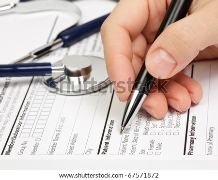 Hand with pen over blank Prescription form with patient information