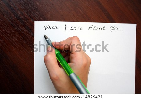 Hand with pen writing a love letter - stock photo