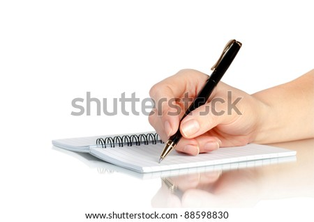 hand with pen writing on notebook and reflection