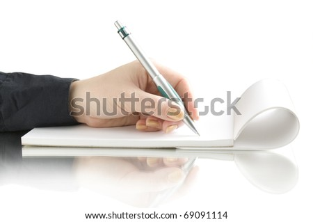 hand with pen writing on the notebook and reflection