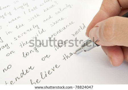 hand with pen writing on the sheet