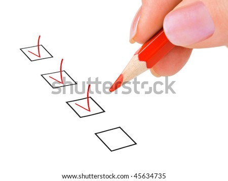 Hand with pencil and check boxes isolated on white background