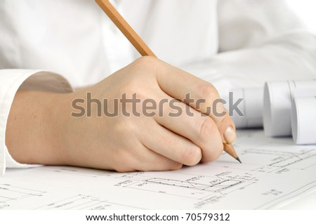 hand with pencil drawing construction plan - stock photo