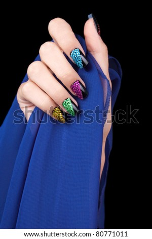 Hand with perfect sparkling colourful manicure