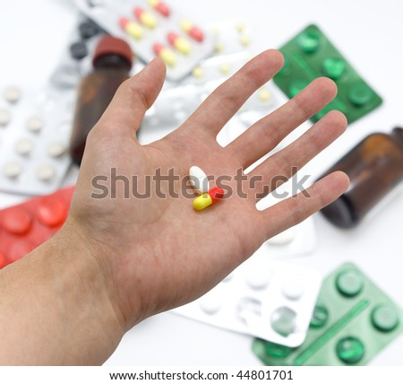 Hand with pills. Element of medical design.