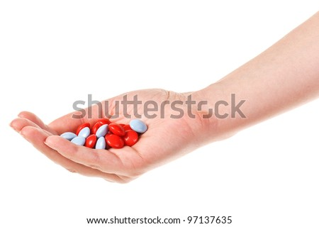 Hand with pills. Isolated over white