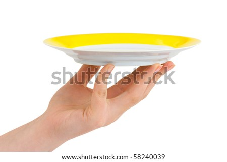 Hand with plate isolated on white background - stock photo