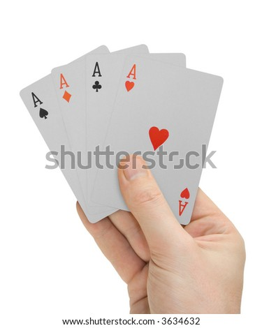 Hand with playing cards (four Aces), isolated on white