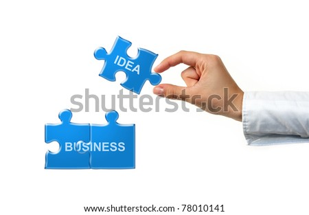 Hand with puzzle and words isolated on white