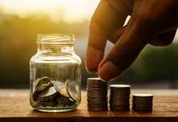 Hand with rows of coins and account for finance and banking concept, Hand with money coin stack growing business, Saving money concept, Save money for retirement planing