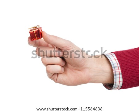 Hand with small toy gift, isolated on white