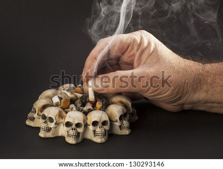 hand with smoke cigarette