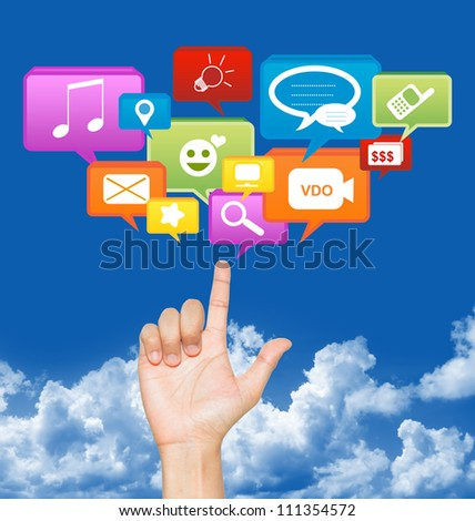 Hand With Social Community Icon Above in Blue Sky Background For Social Network Concept