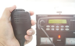 Hand with speakerphone with radio transceiver base station.