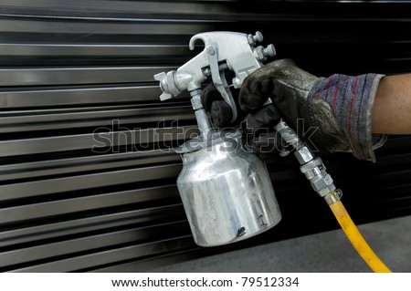 Hand with spray paint gun