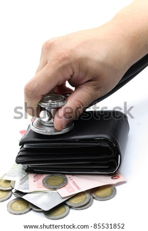 hand with stethoscope examining cash and wallet for diagnosis financial situation