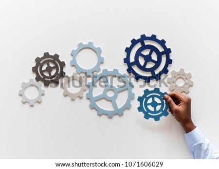 Hand with support gears isolated on white background