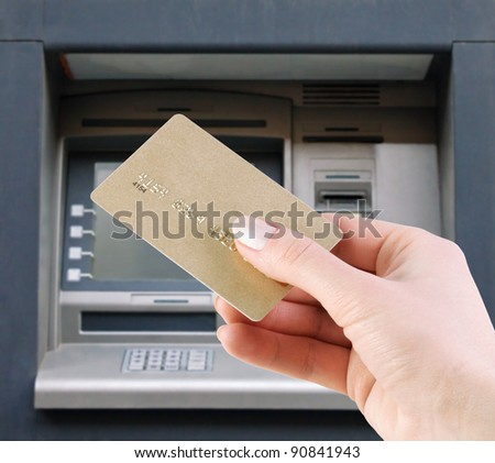 hand with the credit card at the atm