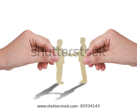 Hand with the paper cut of two business man