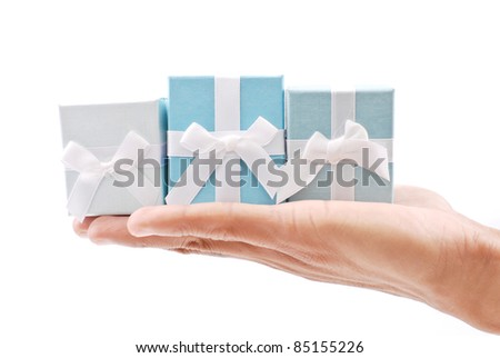 Hand with Three Ring Gift Boxes