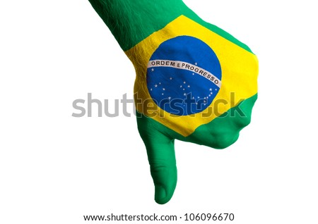 Hand with thumb down gesture in colored brazil national flag as symbol of negative political, cultural, social management of country - stock photo