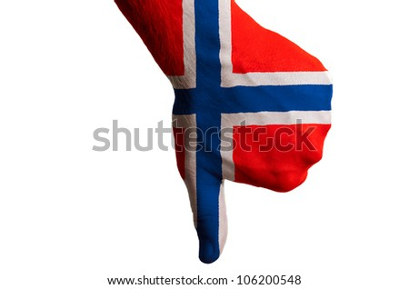 Hand with thumb down gesture in colored norway national flag as symbol of negative political, cultural, social management of country
