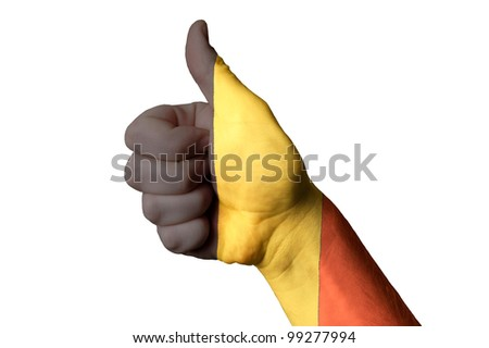 Hand with thumb up gesture colored in belgium national flag as symbol of excellence, achievement, good, - useful for tourism and touristic advertising