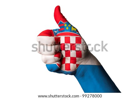 Hand with thumb up gesture colored in croatia national flag as symbol of excellence, achievement, good, - useful for tourism and touristic advertising