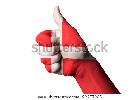Hand with thumb up gesture colored in denmark national flag as symbol of excellence, achievement, good, - useful for tourism and touristic advertising - stock photo